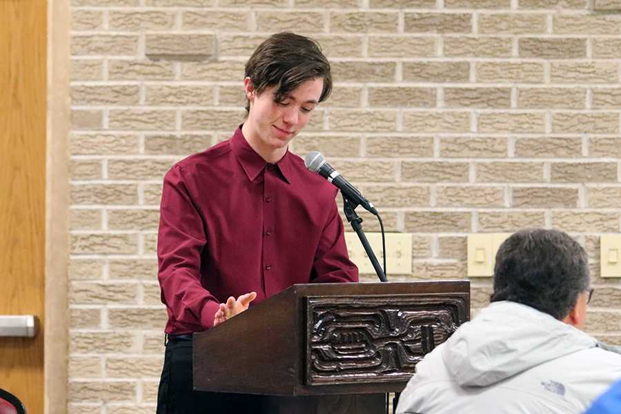 Dylan Foster (12) gets ready to speak at the podium during the Academic Letterwinners banquet on April 13. He was the master of ceremonies for the night. Photo by Kevin Holechko.