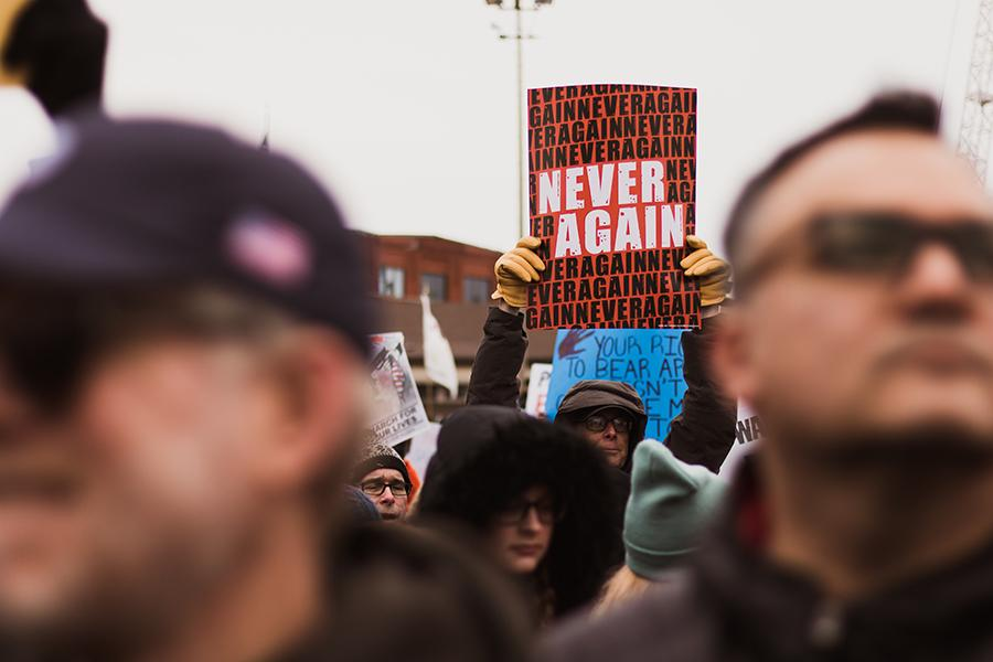 A man joins in a protest in Chicago, Ill. The march was organized by the Stoneman Douglas students and it is reported that over 85,000 people attended. Photo by: Josh Chen (10)