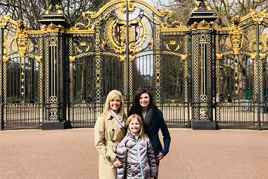 Mrs.+Stephanie+Parks%2C+Science%2C+stand+in+front+of+the+Buckingham+Palace+gates+with+her+two+daughters.+The+Parks+family+visited+London+during+spring+break.+