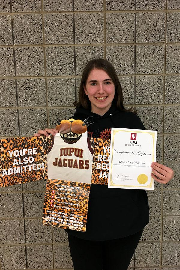 Kylie Thomsen (12) hold her acceptance letter to IUPUI. She will be pursuing a career as a forensic biologist in the FBI.