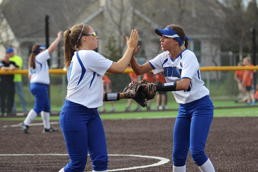 Madisen Tucker (12) and Gabriella Cara (11) high-five during the game. Lake Central beat Crown Point 9-1