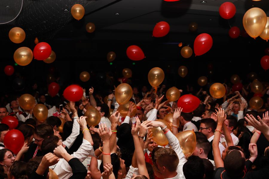 Balloons fall on the crowd following the announcement of the court. A balloon drop was also featured in the prom dance of 2015-2016.