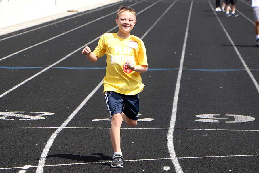 Brendan Hupenthal runs the 25 meter dash. There were over a hundred participants.