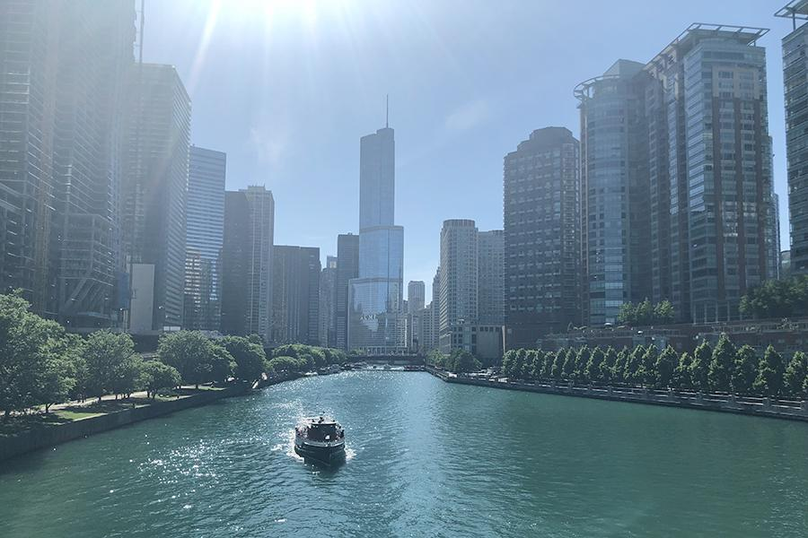 A+boat+flies+down+the+Chicago+River.+The+first+day+of+school+is+August+14.