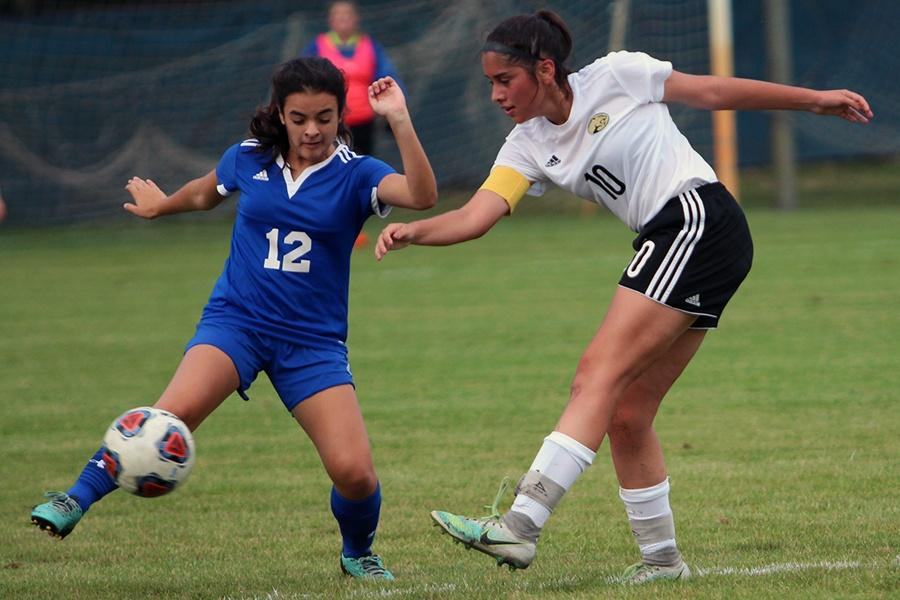 Veronica Ruiz-Avila (10) kicks the ball away from the other team. This is Ruiz-Avila's first year on Varsity.
