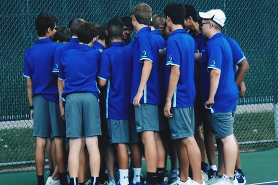 The+Lake+Central+Varsity+and+JV+Tennis+teams+huddle+before+their+match+against+Highland.+The+Lake+Central+boys+defeated+Highland+4-1.+