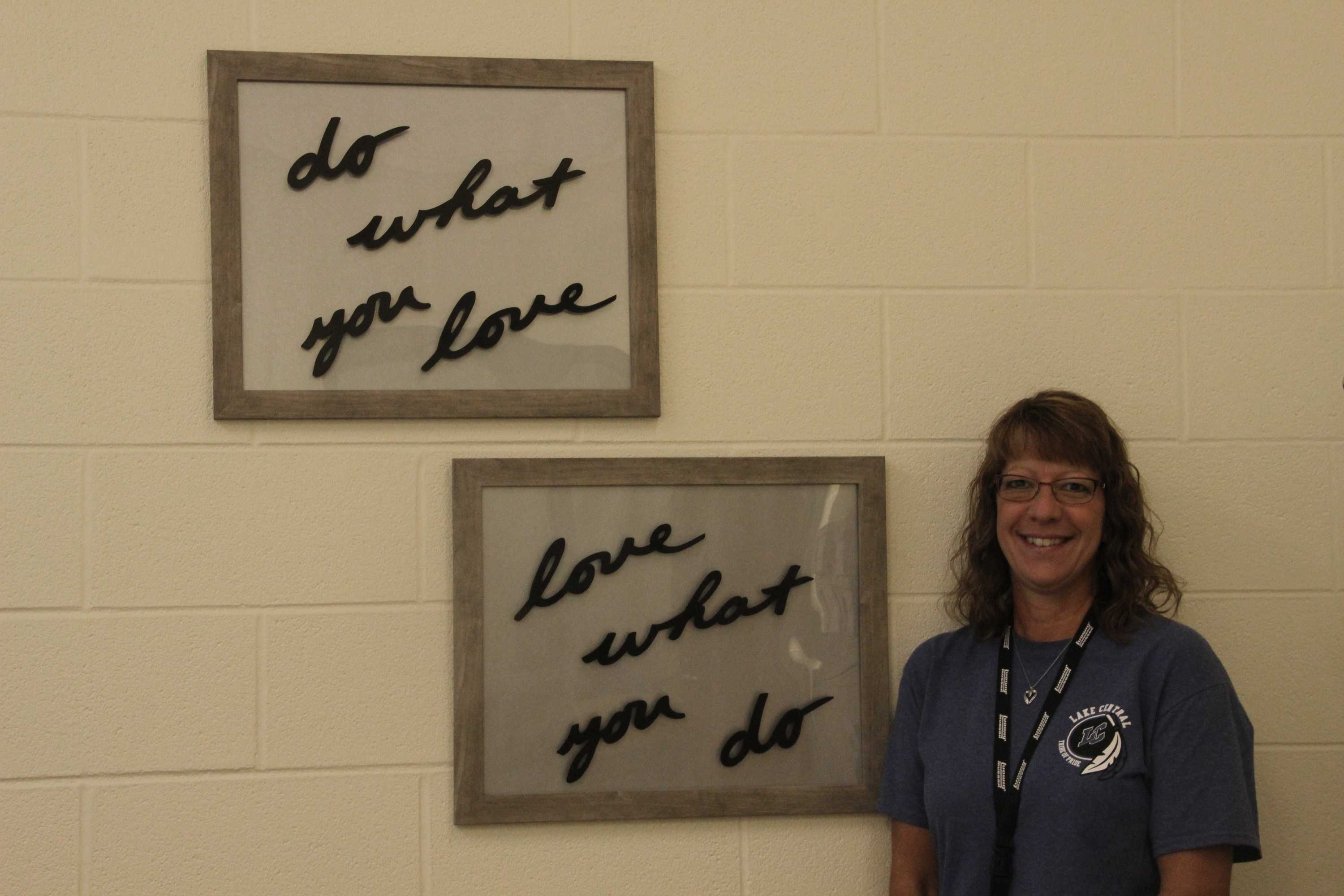Mrs. Renee Swetlik smiles in her new workspace.  She just redecorated her desk area.