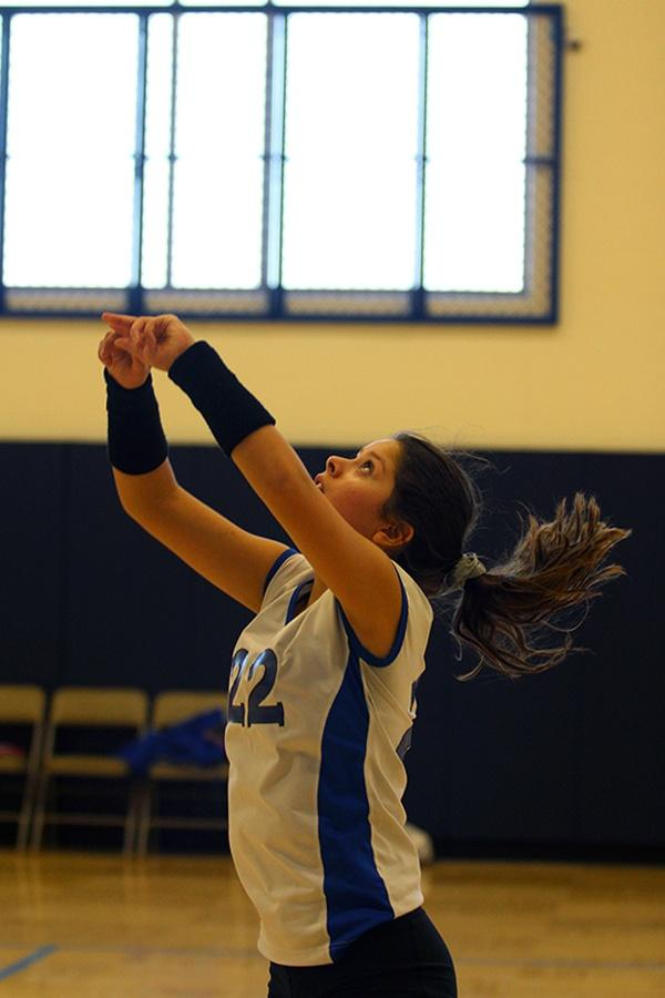 Mina Cardenas (9) anticipates the ball coming over the net. The freshman volleyball team won during their first match against Portage.