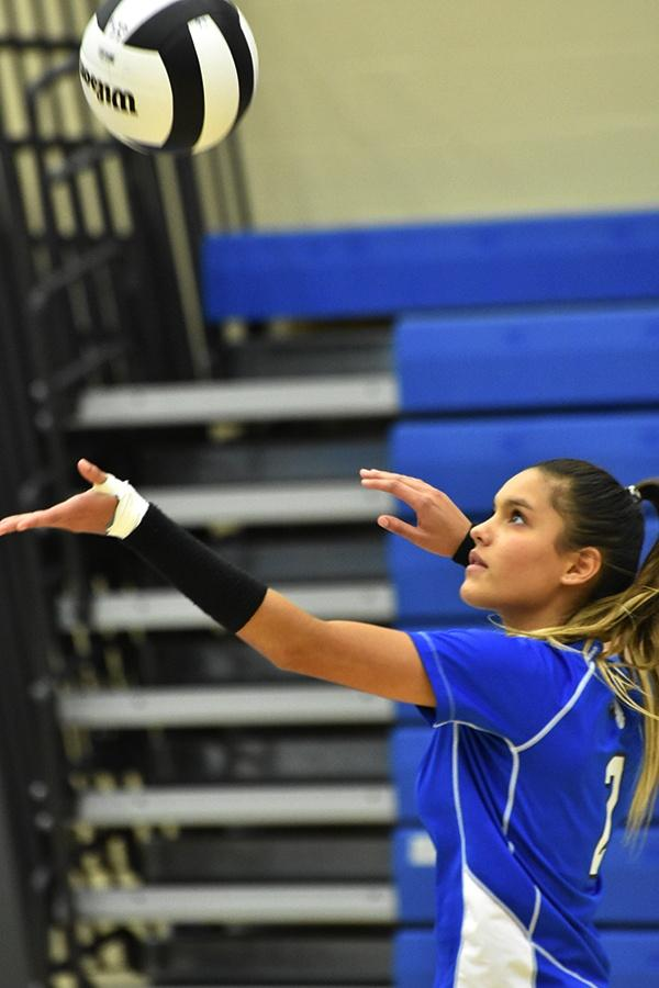 Kenzie Kusbel (11) sets her standards high like the ball to show the Pirates her true competitive spirit.  She has worked hard to be on Varsity. (Image 4)