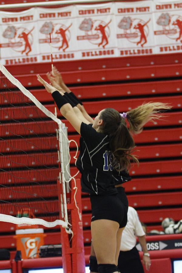 Margaret+Mulligan+%2811%29+and+Amanda+Robards+%2812%29+jump+simultaneously+to+block+the+ball.+Mulligan+has+been+on+varsity+for+two+years%2C+and+Robards+has+been+for+four+years.