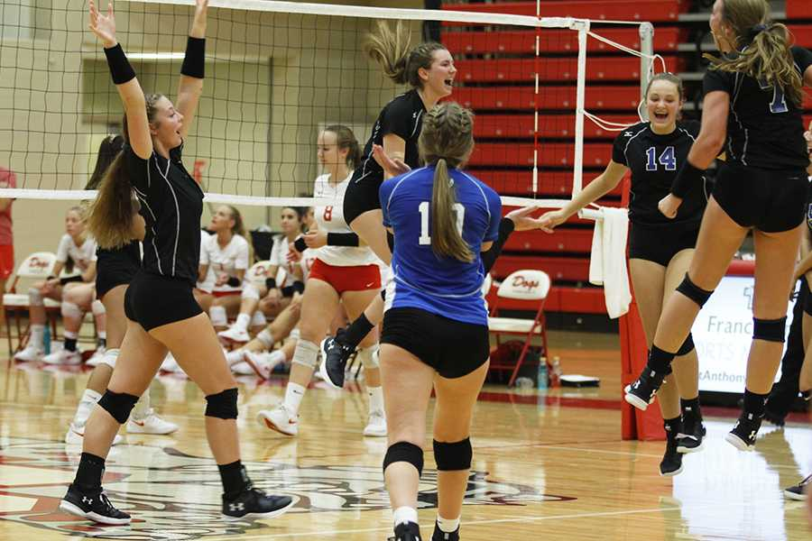 The team jumps with joy after tying the game in the third set. The girls will face Crown Point again in Sectionals.