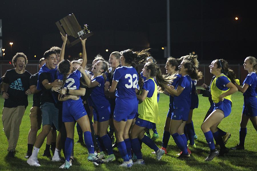 The girls Varsity soccer team celebrates after their Sectional win. Photo By: Camille Bereolos