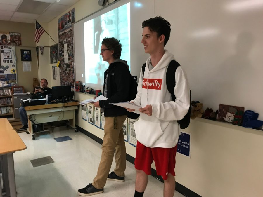 Andrew Gorman (10) and Tommy Serratore (10) talk to Mr. Bryan Szalonek's PTE class about how students can be involved in the ceremony.  Members of the club went around to PTEs and talked to students about inviting veterans they know to sign up to come to the ceremony and how to get involved in the essay contest.