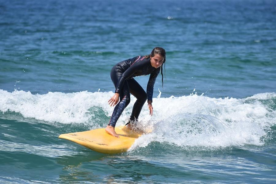 Mckenzie Schilling (10) crouches down as she prepares to ride the next wave. It was an ideal day to surf.  Photo Submitted by: McKenzie Schilling
