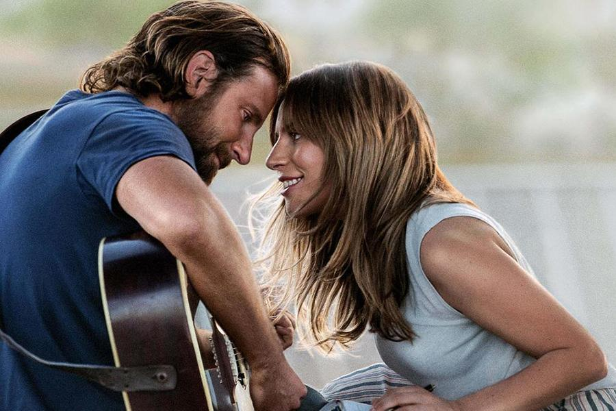 A promotion for the movie Star is Born shows. The movie was directed by Bradley Cooper.