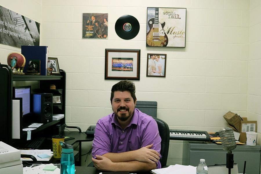 Mr. Nathaniel Jones (music) sits at his desk in his office. This is his third year at Lake Central.