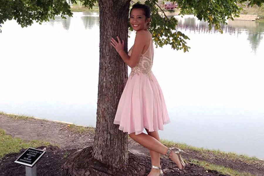 """Sarah Gross (10) posing for homecoming.""""My favorite part [about homecoming] was probably the punch and just dancing in general."""" Gross said."""