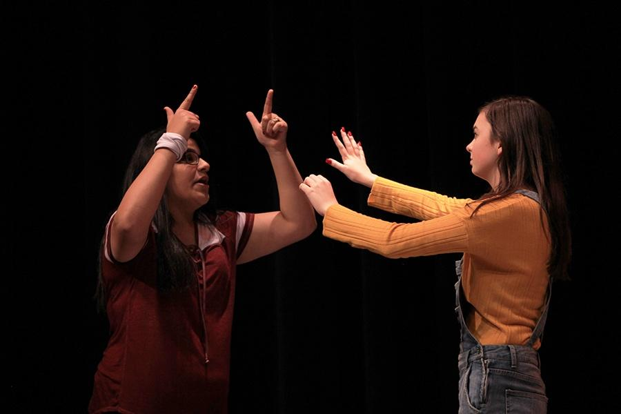 Nicole South (11) and Avery Parks (10) perform together in the Black Box. They both were both apart of the group, Broadway Dropouts.