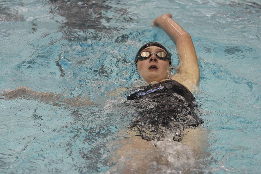 Alyssa+Todd+%2811%29+competes+in+the+100+meter+backstroke.+Todd+swam+up+in+the+varsity+event+even+though+she%E2%80%99s+still+on+the+junior+varsity+team.