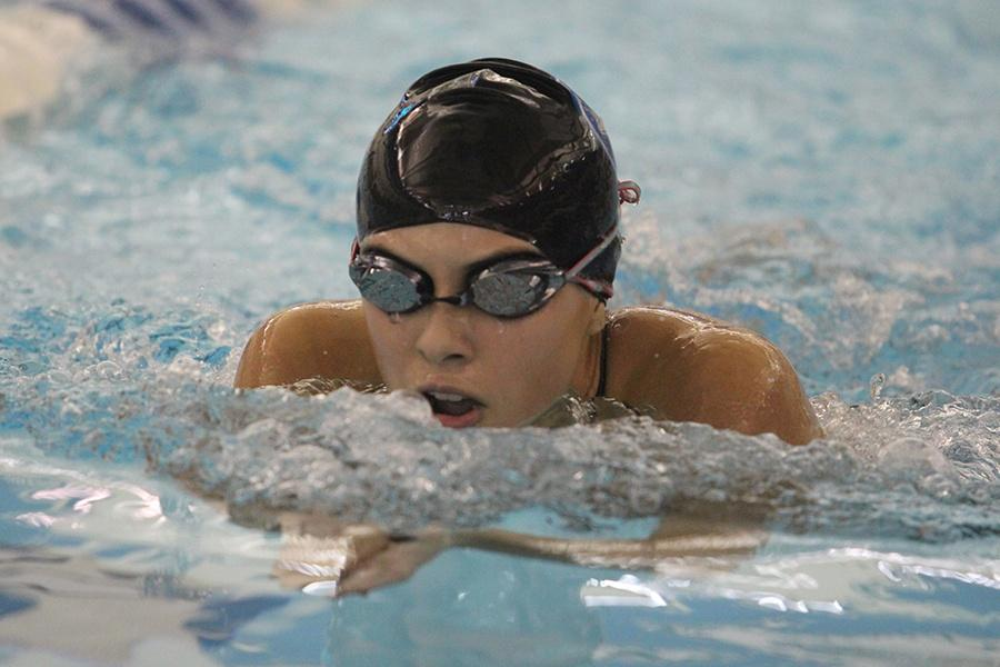 Natalia Mendoza (11) competes in the breaststroke event. Mendoza tried to win the race and beat her personal record.