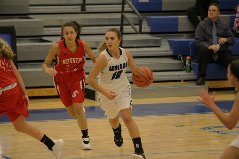 Tiana Morales (10) handles the ball near the hoop.  Morales was a key to the win.