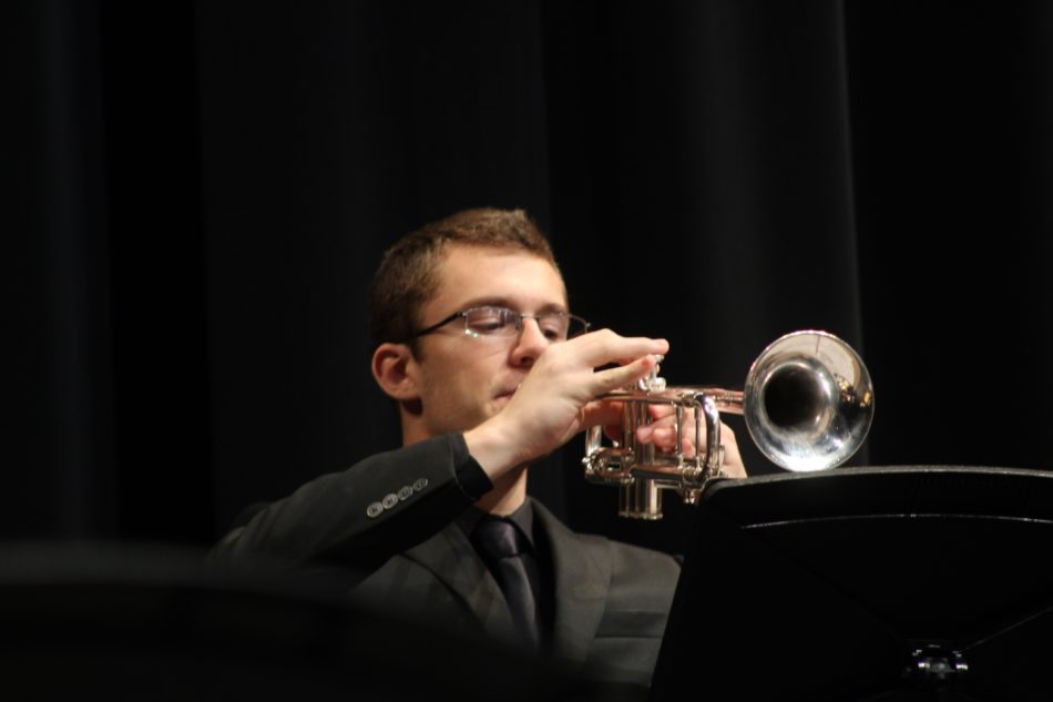 Alex Tarnowski (12) plays his heart out. Many students enjoyed the satisfaction of performing in front of their peers.