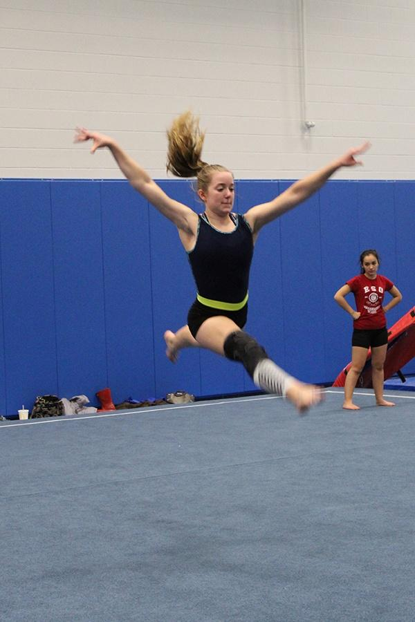 Allison+Mybeck+%2810%29+leaps+across+the+floor.+She+was+improving+her+flexibility+for+a+switch+ring.