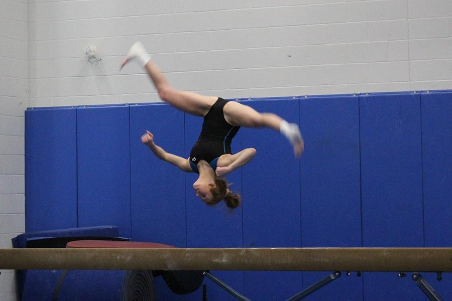 Sophia+Born+%2812%29+does+an+aerial+on+the+beam.+She+was+working+on+perfecting+the+skill+for+the+first+meet.+