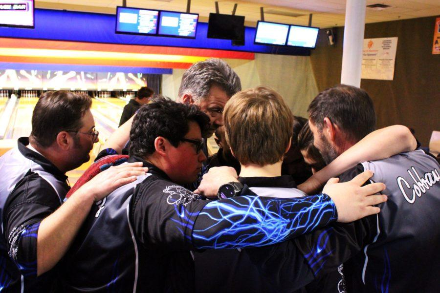 The+varsity+team+huddles+after+finals%2C+knowing+they+placed+second.+They+only+lost+to+the+undefeated+team+of+Griffith.+