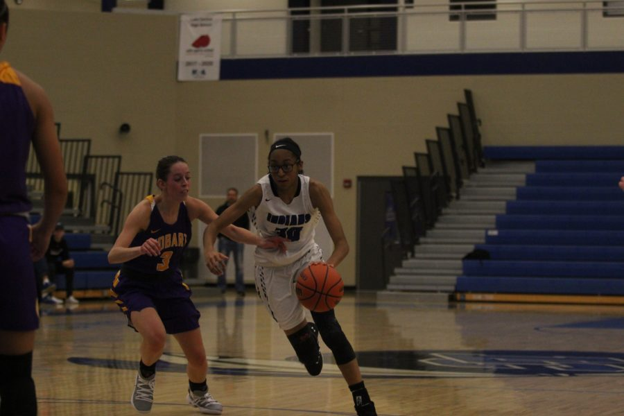 Essence+Johnson+%289%29+maneuvers+her+way+past+a+defender.+Johnson+was+the+only+freshman+to+play+during+the+game.