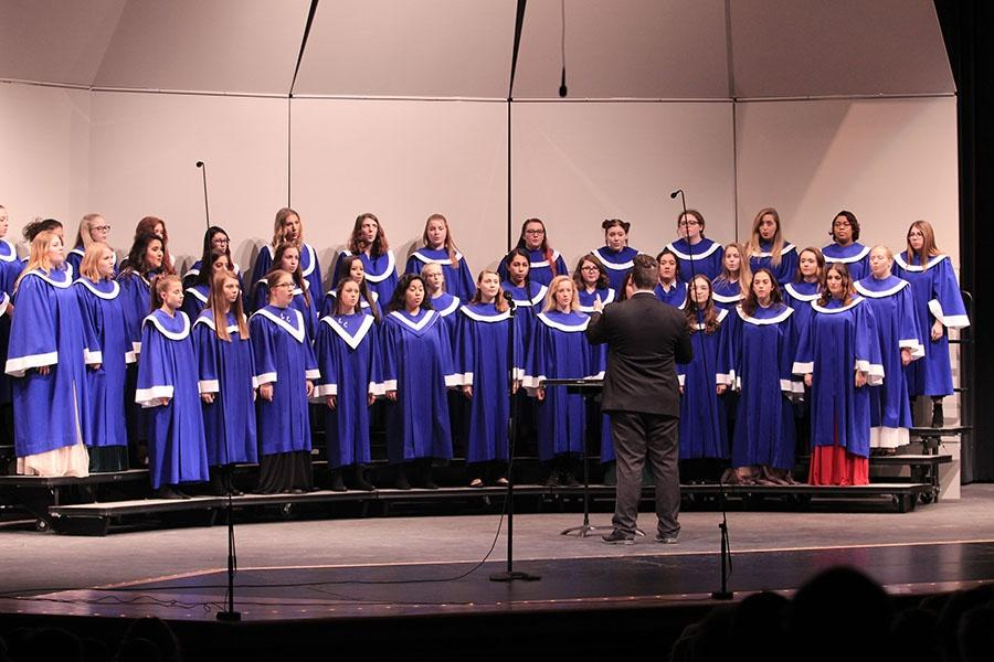 Mr. [Nathaniel] Jones [choir director] conducts the Senior Treble choir during their performance of December Child. The chorus also performed Welcome Christmas and Three Jazzy Bell Carols.