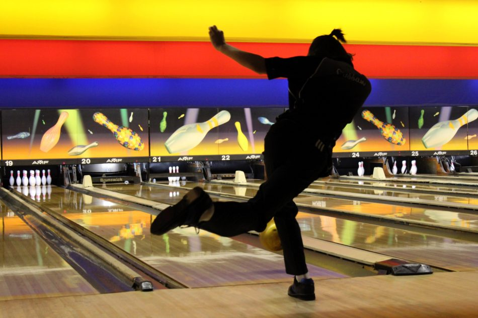 Brett Cobban (12) throws his bowling ball down the lane. He was warming up before the tournament.