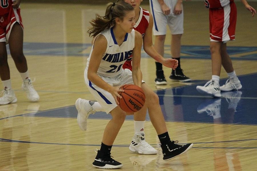 Olivia+Balog+%289%29+uses+her+footwork+to+try+and+get+around+the+other+player+so+she+can+get+to+her+basket.++Lake+Central+received+points+not+too+long+after+that.