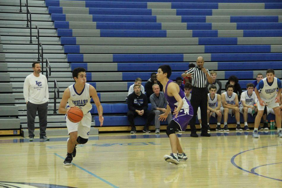 Kyle+Blum+%2811%29+dribbles+the+ball+to+pass+to+one+of+his+teammates+to+score+a+point.+Unfortunately%2C+they+did+not+get+the+point+for+the+team.++