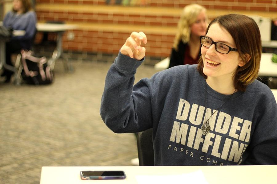 Mackenzie Moore (12) signs the alphabet. Moore took a class in fifth grade where she learned basic sign language and the pledge.