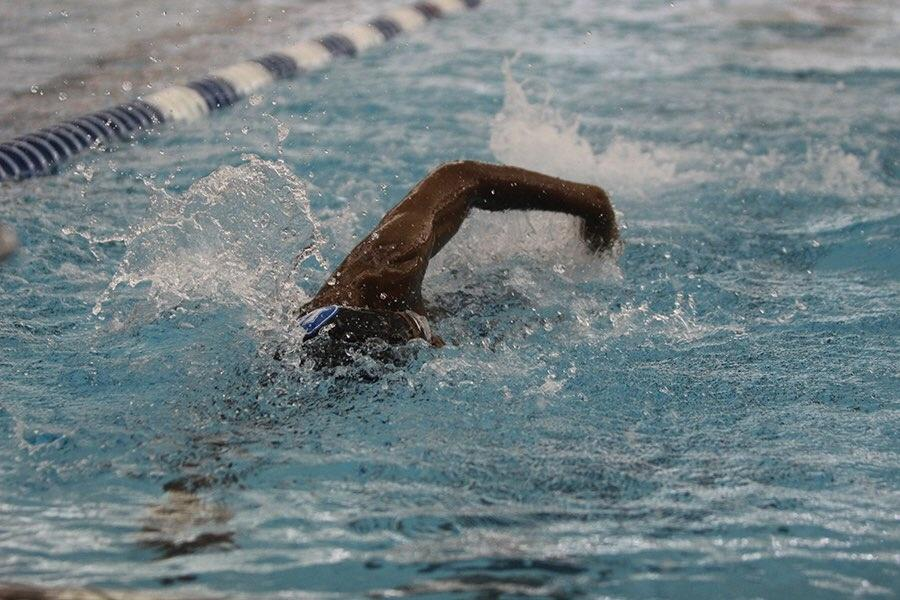 A+JV+swimmer+battles+against+his+Chesterton+opponent+as+he+comes+close+to+the+wall+while+swimming+freestyle.