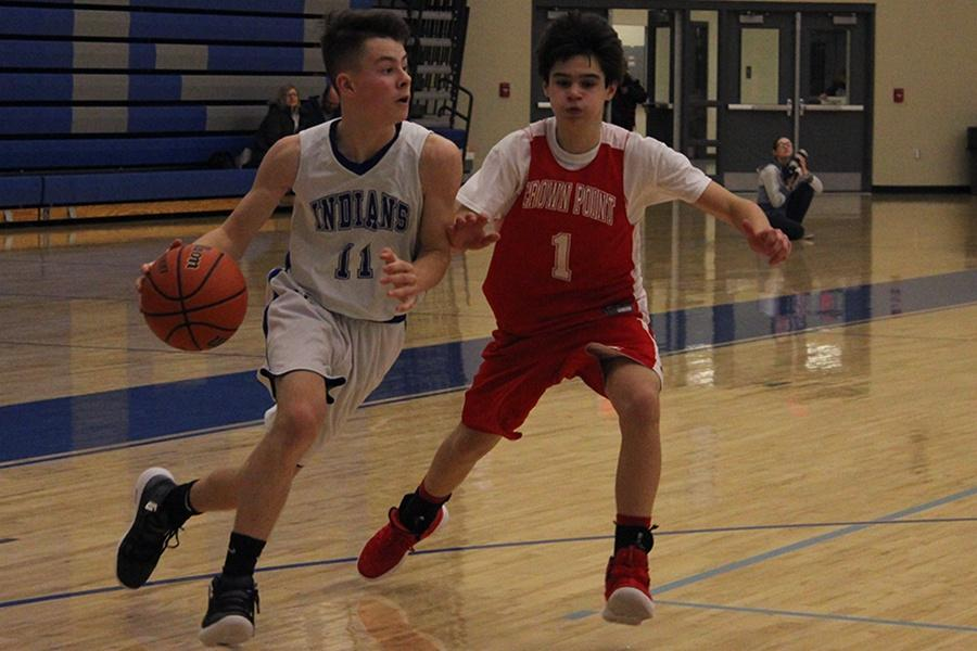 Zachary Vollrath (9) dribbles the ball while a Crown Point player tries to box him out. Vollrath outran his rival and passed the ball on to his teammate.