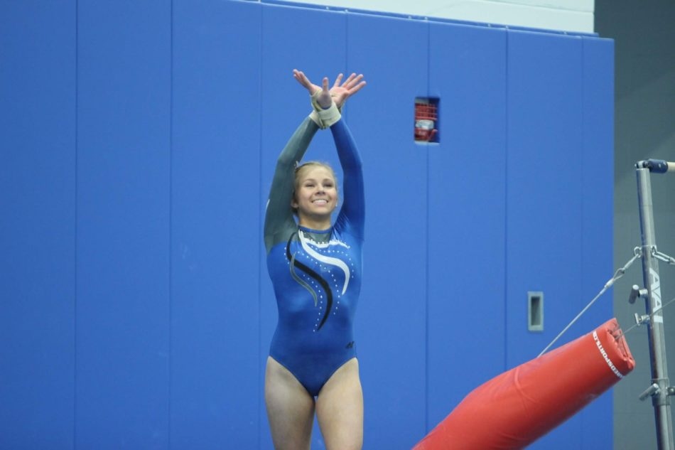 Sophia Born (12) smiles as she is about to start her floor routine. She ended up getting a score she was not happy about.