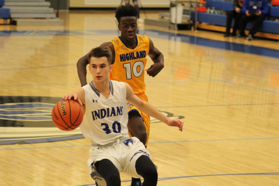 Mark Mileusnic (10) runs with the ball and moves towards the basket. Towards the end, the game was close, but the Indians pulled off a win.