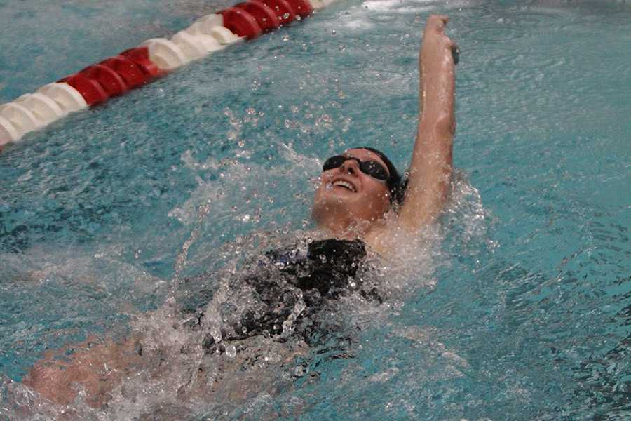 Alyssa Todd (10) smiles during the backstroke event. The girls defeated Munter 102-83.