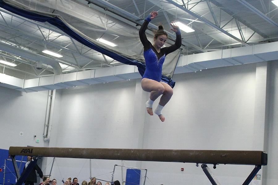 Madison+Mullens+%2812%29+jumps+that+leads+into+one+of+her+beam+tricks.++Mullens+has+been+on+the+team+for+four+years.