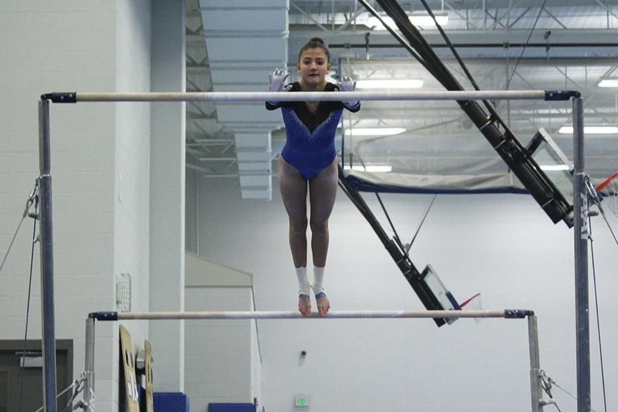 Gabrielle+DeVries+%2812%29+leaps+into+the+air+during+her+bar+performance.+DeVries+placed+third+in+All-Around.
