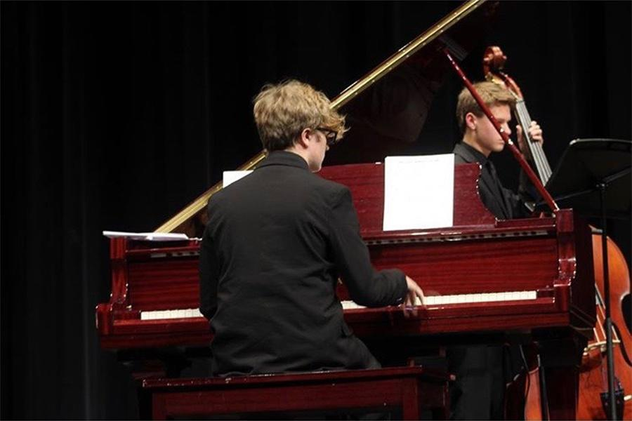 Nate Sorrentino (10) plays the piano during a jazz concert. This was Sorrentino's second year in the Jazz band. Photo Credit: Sarah Huszar (10)