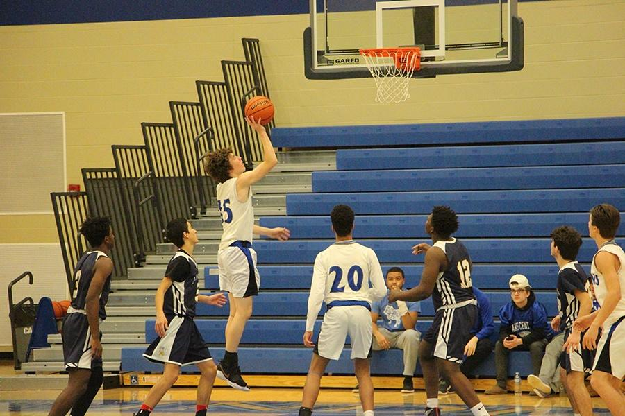 Ethan Knopf (9) goes in for a layup.  Knopf made many points throughout the game. Photo by: Audrey Difillipo