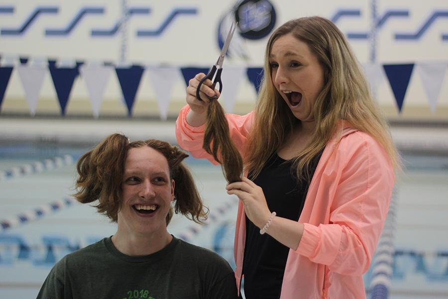 Michael Zajac (12) shaves his head in the pool on Friday, Feb. 15. Zajac donated his hair to Locks of Love.