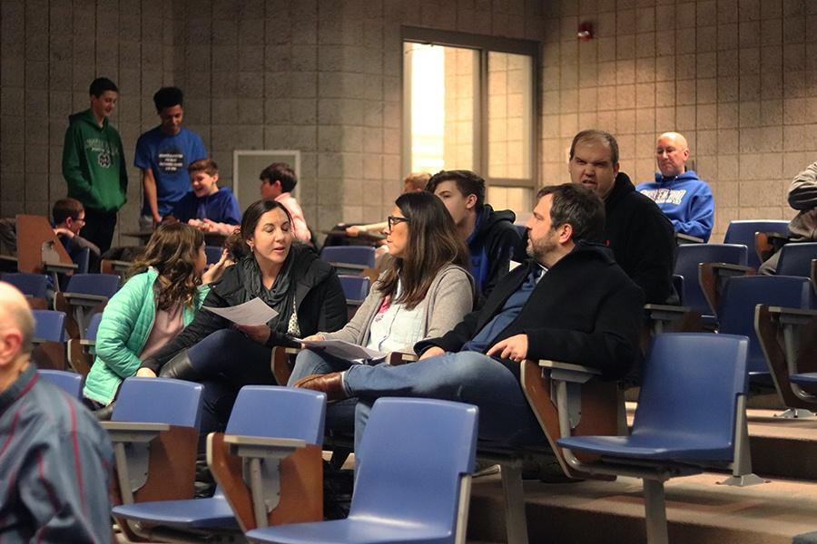 Community+members+arrive+for+the+Feb.+4+School+Board+Meeting.+The+seventh+and+eighth+grade+Grimmer+basketball+team+was+honored+by+the+board.+