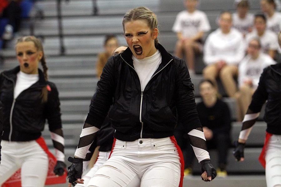 Carly Gibson (12) gets in the zone while performing their hip-hop dance. There were many schools that travelled to St. John for the competition.