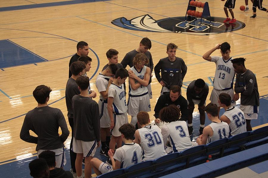 Coach Fry talks with the boys right before the second half. Even though they were more than four times the other team's score, the boys pushed to the hoop every chance they got.