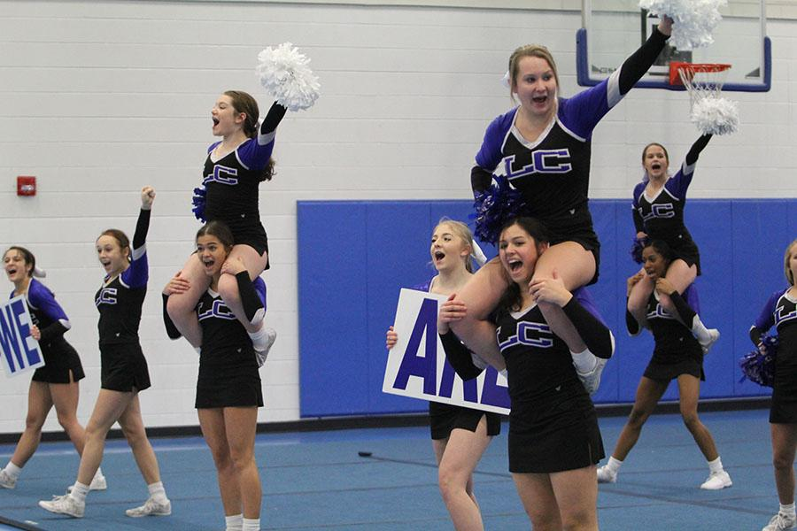 The+varsity+cheerleaders+lead+the+crowd+in+chants.+The+team+hit+their+routine+before+leaving+for+Nationals.+