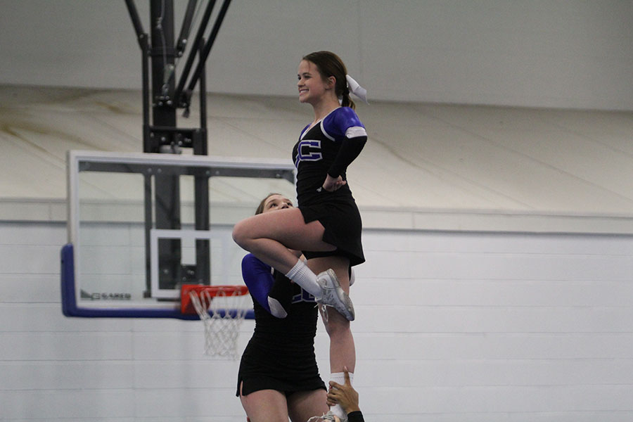 Marissa+Penwitt+%2811%29+strikes+a+pose+as+a+flyer.+The+girls+had+to+change+some+of+their+stunt+groups+due+to+team+injuries.+